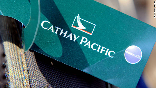 A Cathay Pacific luggage label on a suitcase