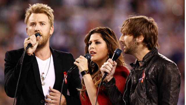 """Helping rebuild this community is our biggest priority right now,"" Lady Antebellum's Hillary Scott (center) said."