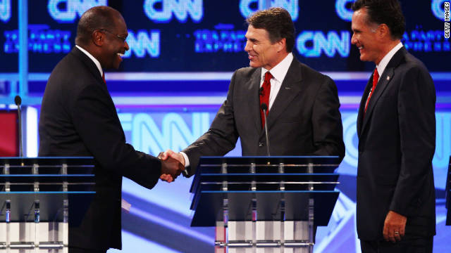 GOP presidential candidates Herman Cain, from left, Rick Perry and Mitt Romney chat after Monday's debate.