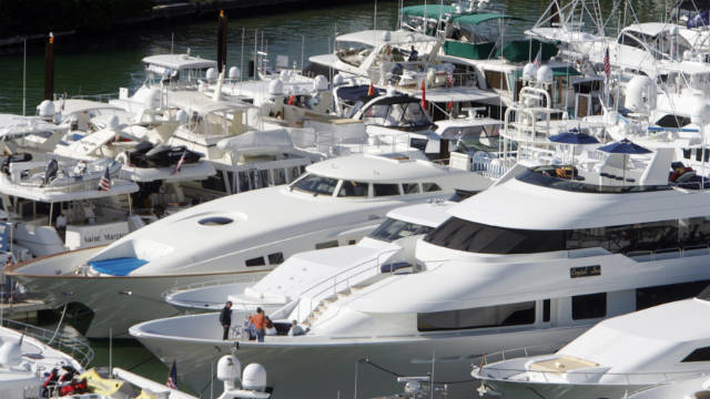 Luxury yachts are displayed in Miami. Sally Kohn says more money for the rich means more yachts, not more jobs.