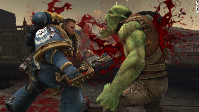 "Titus, the main character in ""Warhammer 40,000: Space Marine,"" attacks an ork."