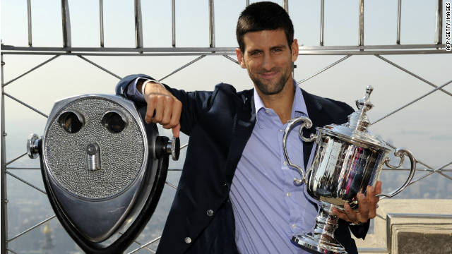 Novak Djokovic poses with his U.S. Open trophy atop the Empire State Building in New York  on Tuesday.