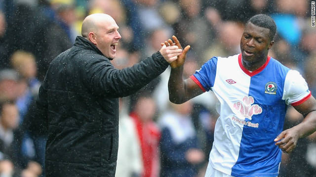 Blackburn manager Steve Kean congratulates  Ayegbeni Yakubu after he scored his second goal at Ewood Park