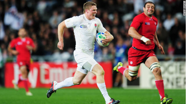 England's Chris Ashton bursts clear to score his side's fifth try against Georgia
