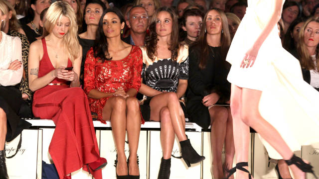 "Pippa Middleton (center) was wearing the ""classic fan dress"" from the label's current autumn/winter collection."