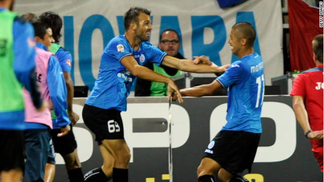 Novara's Riccardo Meggiorin (L) celebrates with Takayuki Morimoto after scoring the opening goal in their 3-1 win over Inter MIlan