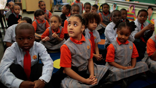 "Students sit patiently at Harlem Success School, praised in the book ""Class Warfare"" as a high-achieving charter school."