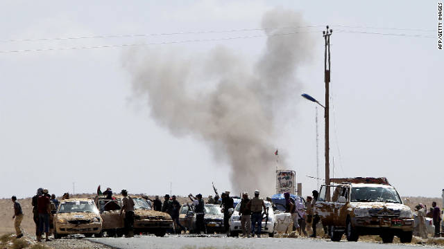 Gadhafi loyalists attack Libyan National Transitional Council fighters at an outpost near Bani Walid on Wednesday.