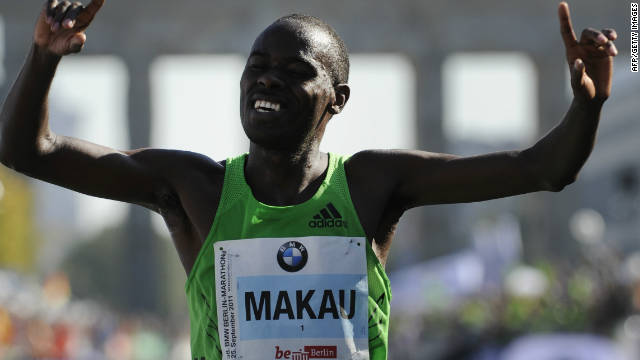 Patrick Makau of Kenya celebrates his new world record in the marathon