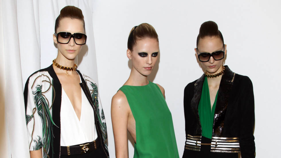 Models pose backstage at the Gucci Spring/Summer 2012 fashion show as part Milan Womenswear Fashion Week.