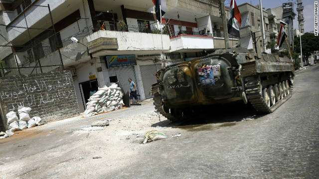 A Syrian military tank takes position in the city of Homs on August 30, 2011 (file photo).