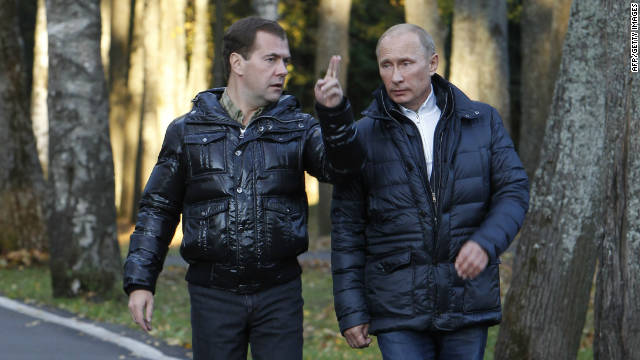 Russia's President Dmitry Medvedev, left, walks with Prime Minister Vladimir Putin in the Tver region on September 24.