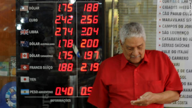 A man walks past a quotation board at a buereau de change in downtown Rio de Janeiro on September 20.