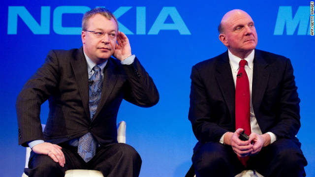 Nokia CEO Stephen Elop, left, with Microsoft CEO Steve Ballmer onstage after announcing their partnership.
