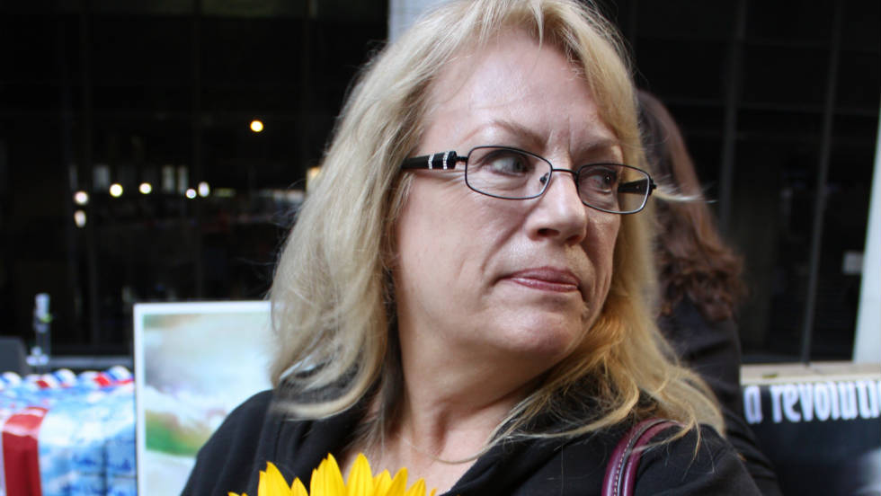 "Betty Byrnes passed out sunflowers for a Michael Jackson support group called ""Call for Love."" ""It's the first day of justice and that's really exciting, but there's not going to be any real justice. It won't bring him back,"" she says."
