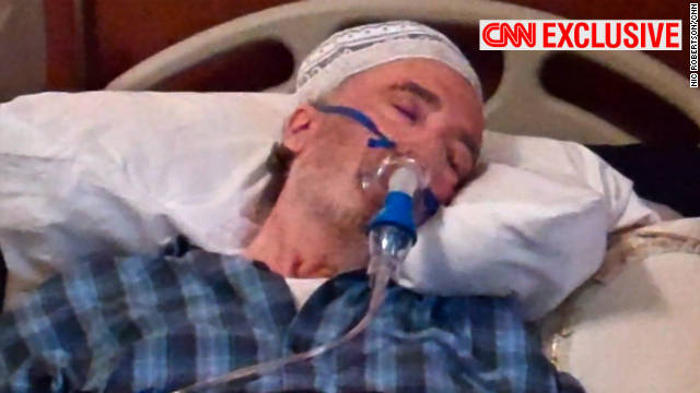 CNN found Abdel Basset l-Megrahi under the care of his family in his palatial Tripoli villa, surviving on oxygen and an intravenous drip.
