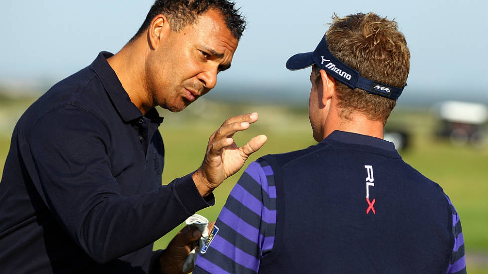 Dutch football legend Ruud Gullit in discussion with world number one Luke Donald.