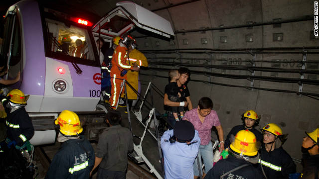 Rescuers evacuate passengers after the subway train collision on September 27.