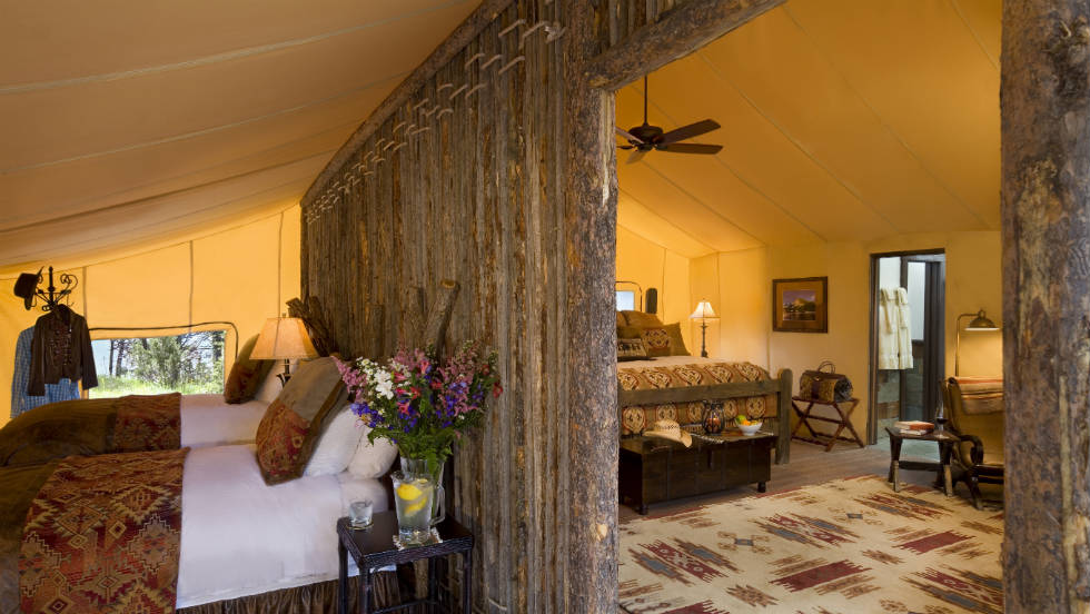 At Paws Up, two-bedroom tents have a rustic lodge feel.