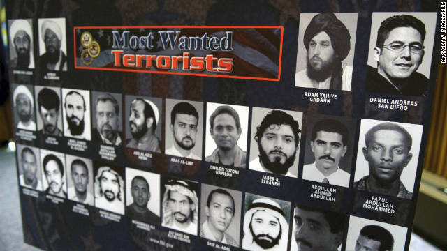 "A file photo shows a ""Most Wanted Terrorists"" poster showing the top 24 wanted terrorists in 2009."