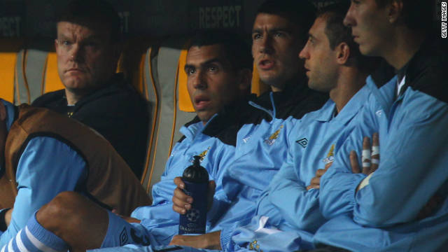 Carlos Tevez sits with the other Manchester City substitutes at the Allianz Arena on Tuesday.