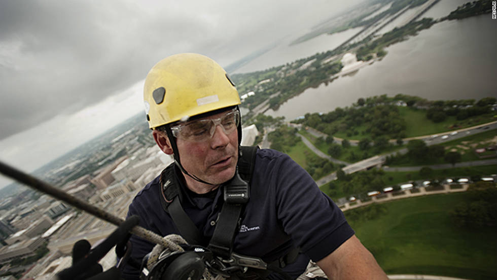 David Megerie traverses the exterior of the Washington Monument. Megerie is a contractor with Wiss, Janney, Elstner Associates, the engineering firm leading the inspection.