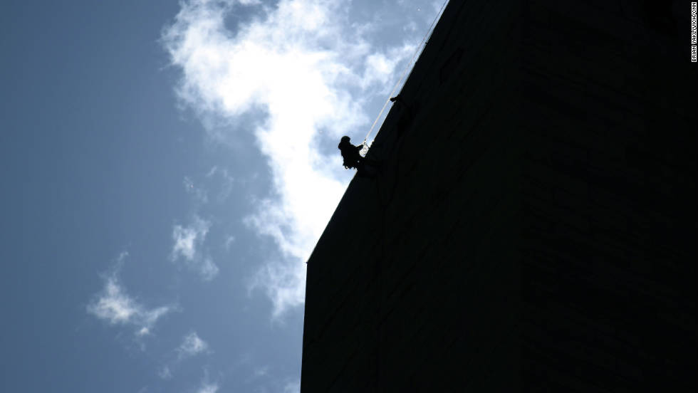A worker descends the length of the monument after the earthquake. Officials said the heaviest damage seemed to be near the top of the structure.