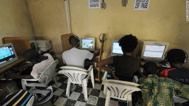 Young Africans browsing the internet in a cybercafe in Ivory Coast.