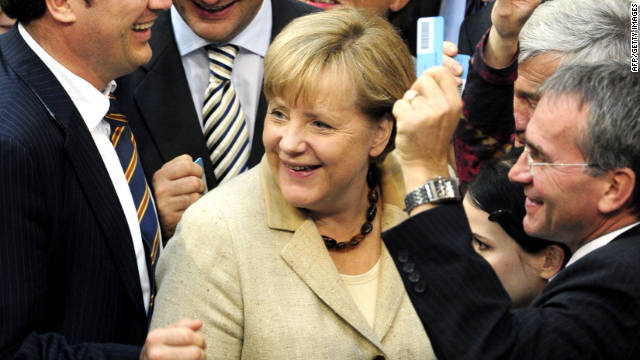 Chancellor Angela Merkel (C) stands by MPs as they cast their ballot on September 29, 2011 at the Lower House of German parliament Bundestag in Berlin as lawmakers vote on legislation to expand the EU's rescue fund. German Chancellor battled to contain a backbench rebellion as the world looks to her for a solution to the eurozone debt crisis. The Euro fund bill passed German parliament with large majority.
