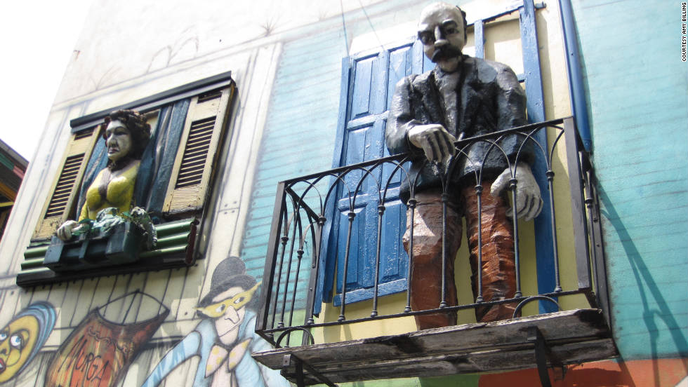 "Amy Billing snapped this shot of Buenos Aires street art. ""Caminito Street in the barrio of La Boca in Buenos Aires is filled with amusing figures, street art and colorfully painted homes. It is also common to catch a short glimpse of a tango dance in the streets."""