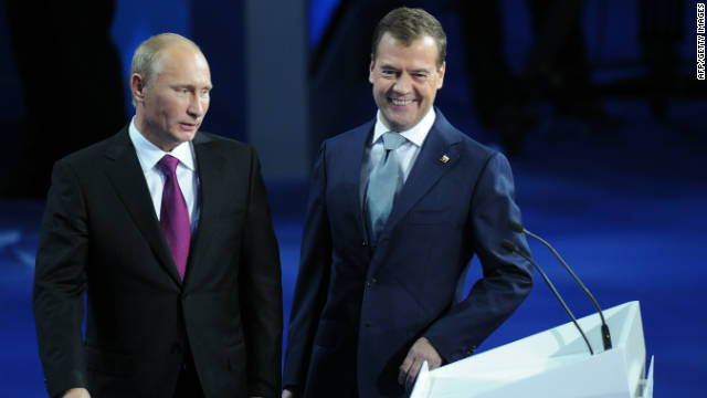 Dmitry Medvedev (R) and Vladimir Putin make a joint appearance at a congress of the United Russia party on September 24.