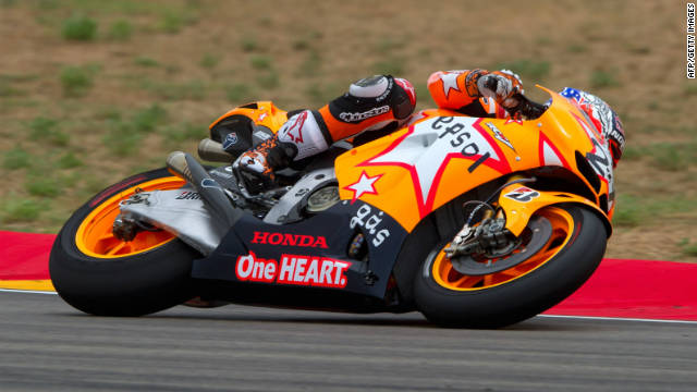 Honda rider Casey Stoner is on track to defend his Japan Grand Prix title on Sunday.