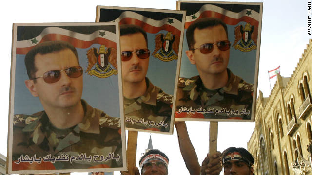 "Supporters of Syrian President Bashar al-Assad at a recent demonstration. The U.S. asked Assad to""step down now"" following the assassination of a prominent Kurdish opposition figure."