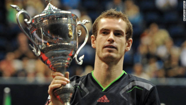 Andy Murray holds aloft the Thailand Open trophy after his easy win over Donald Young
