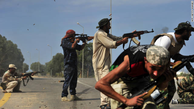 National Transitional Council fighters battle loyalist forces in Sirte, Libya, on Saturday.