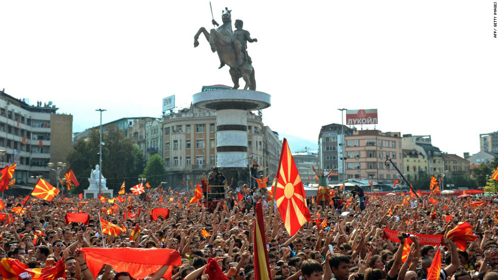 Crowds celebrate the European success of the Macedonian national basketball team in front of the new Warrior on a Horse statue in Skopje's main square.