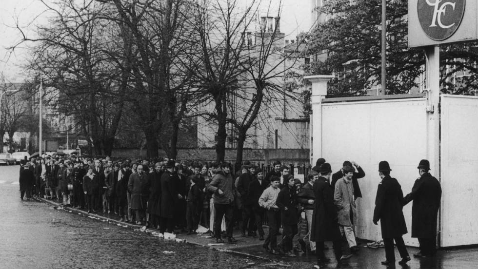 Chelsea fans queue for tickets to the 1970 FA Cup final replay between Chelsea and Leeds United, outside their club's Stamford Bridge ground.