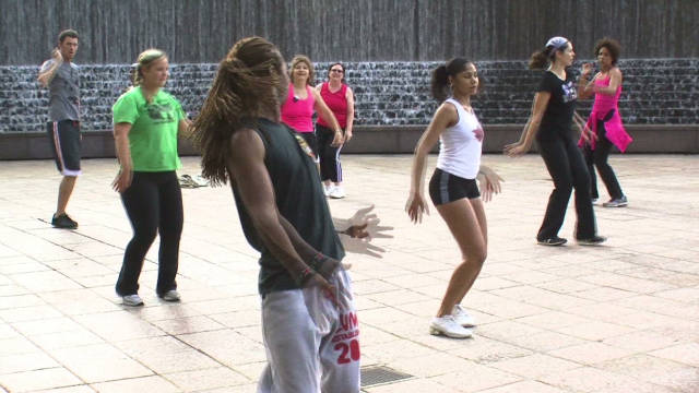 People take part in a Zumba class in an Atlanta park.