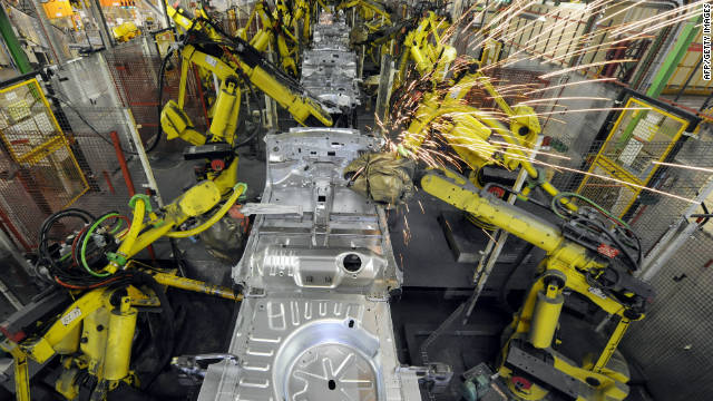 File picture taken on February 17 of robots working at the assembly line of French carmaker PSA Peugeot-Citroen automobile factory in Rennes, western France.