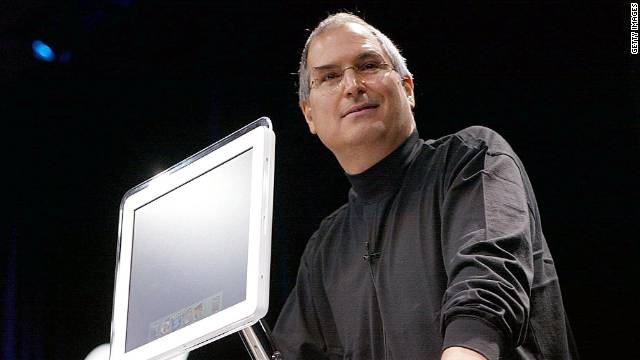 Apple Computer co-founder and CEO Steve Jobs introduces the all-new flat-panel iMac computer during his keynote speech at the MacWorld Expo in January 2002.