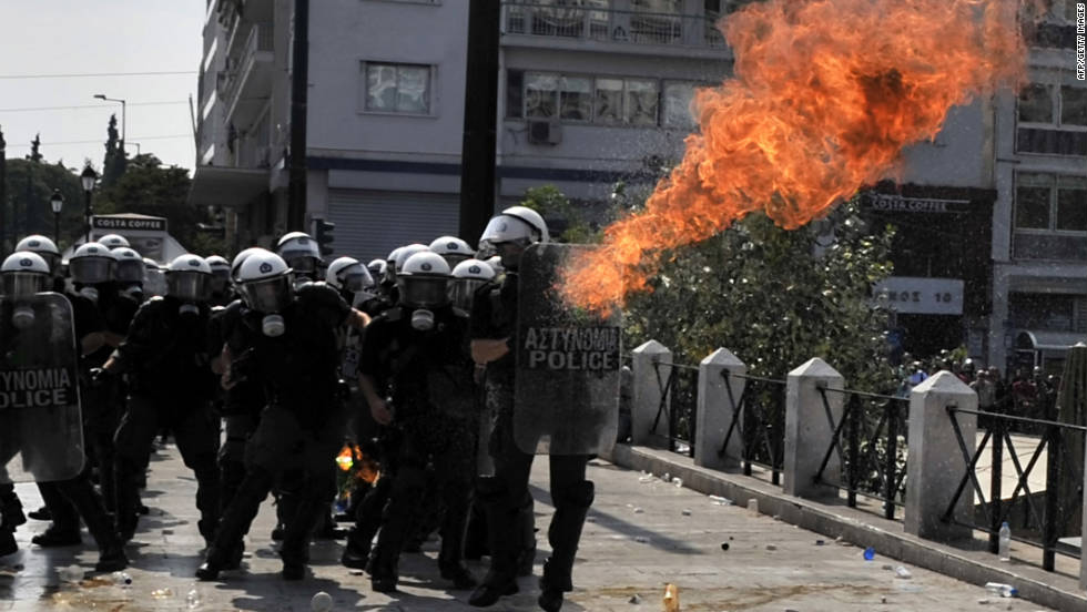 A molotov fire bomb explodes by police during a protest in front of the Greek Parliament in Athens on Wednesday, October 5. At least 10,000 marchers shut down the center of the Greek capital Wednesday to protest the latest waves of austerity measures announced by the government.