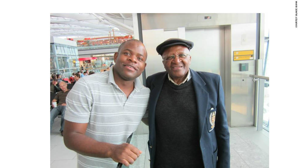 "After spotting the Archbishop in London's Heathrow airport, iReporter Blaise Buma summoned up the courage to ask Tutu for a photo. ""He immediately jumped from his seat and asked his aide to take the picture. I was humbled by the experience,"" he said."