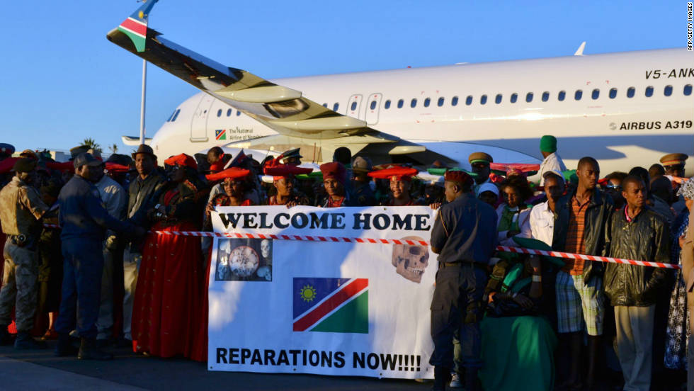 Thousands flocked to Namibia's Hosea Kutako International Airport Tuesday, praying, singing and chanting as the 20 skulls were returned to the country.