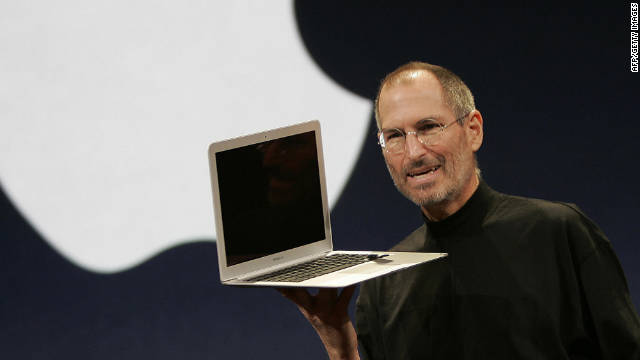 Apple CEO Steve Jobs smiles as he shows off the new Macbook Air an ultra portable laptop during his keynote speech at the MacWorld Conference & Expo in San Francisco, California, 15 January 2008. AFP Photo/ Tony AVELAR (Photo credit should read TONY AVELAR/AFP/Getty Images)