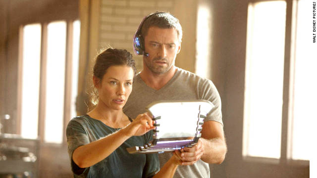 "Hugh Jackman stars as Charlie Kenton and Evangeline Lilly stars as Bailey Tallet in ""Real Steel."""