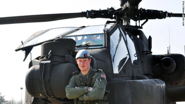 Prince Harry stands in front of his Apache Helicopter while he was in the French Alps on his Mountain Flying training in March 2011.