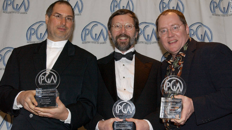 "<a href=""http://www.cnn.com/specials/tech/steve-jobs-the-man-in-the-machine"">Jobs</a>, from left, Ed Catmull and John Lasseter celebrate an award for Pixar at the 13th Annual Producers Guild Awards in March 2002 in Los Angeles."