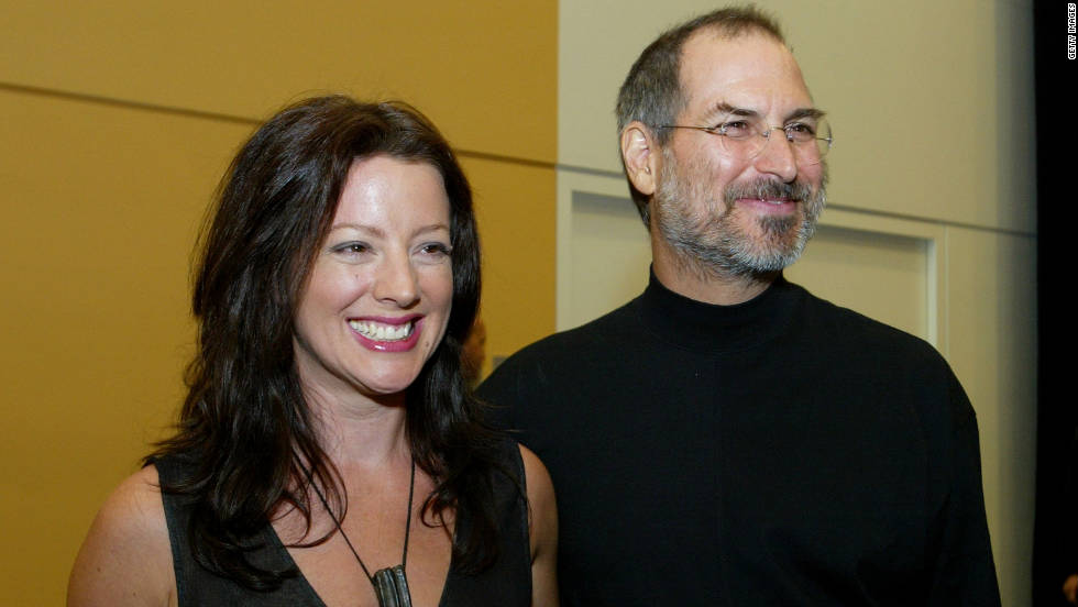 "<a href=""http://www.cnn.com/specials/tech/steve-jobs-the-man-in-the-machine"">Jobs</a> stands with singer Sarah McLachlan after delivering a speech in San Francisco in 2003."