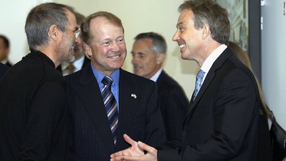 "British Prime Minister Tony Blair, right, talks with <a href=""http://www.cnn.com/specials/tech/steve-jobs-the-man-in-the-machine"">Jobs</a>, left, and Cisco Systems CEO John Chambers during a meeting of Silicon Valley executives at Cisco headquarters in July 2006."