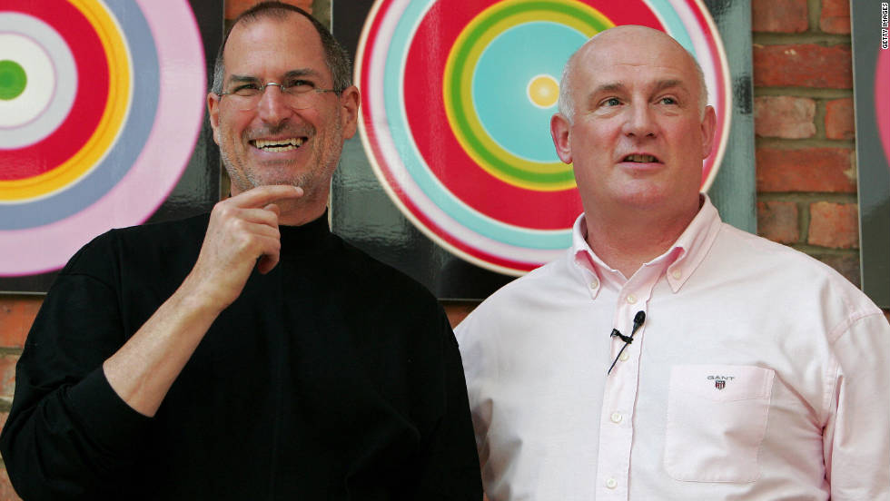 "<a href=""http://www.cnn.com/specials/tech/steve-jobs-the-man-in-the-machine"">Jobs</a> laughs as he poses with Eric Nicoli, chief executive officer of EMI, while promoting a new partnership in London in April 2007."